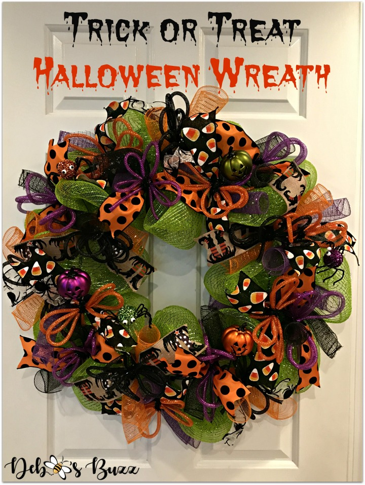 halloween-wreath-trick-or-treat-design-white-door