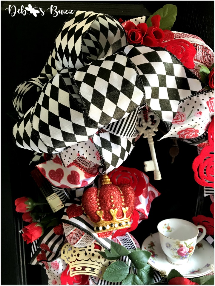 alice-in-wonderland-theme-wreath-tea-roses-bow-black-door