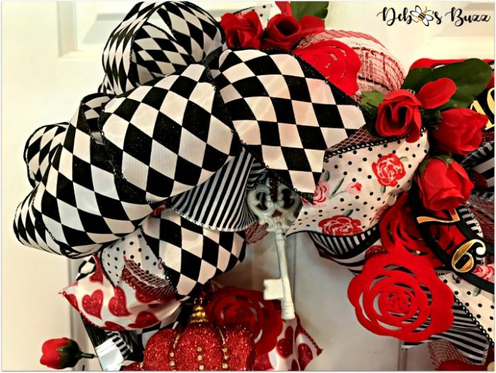 alice-in-wonderland-theme-wreath-tea-roses-bow-white-door