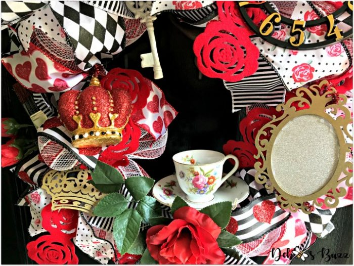 alice-in-wonderland-theme-wreath-tea-roses-feature-black-door