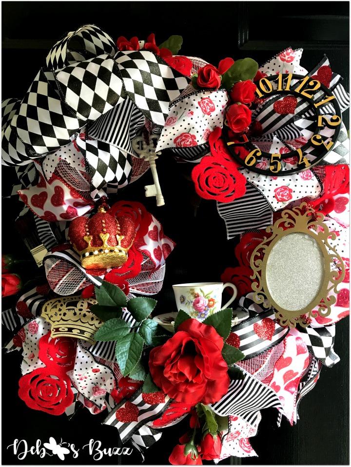 alice-in-wonderland-theme-wreath-tea-roses-full-closeup-black-door