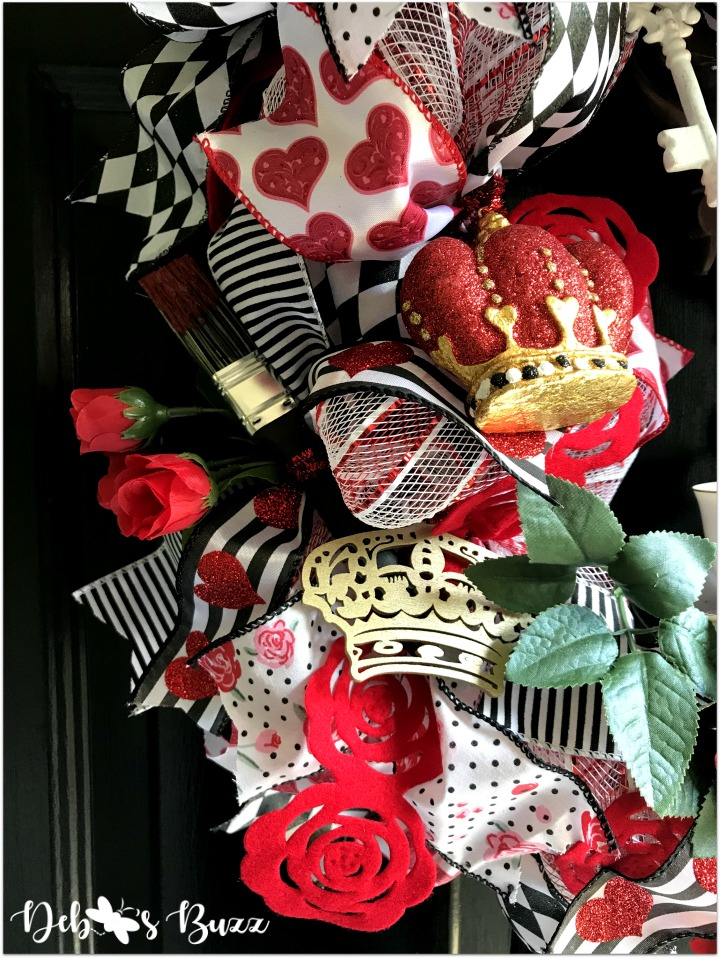 alice-in-wonderland-theme-wreath-tea-roses-paintbrush-black-door