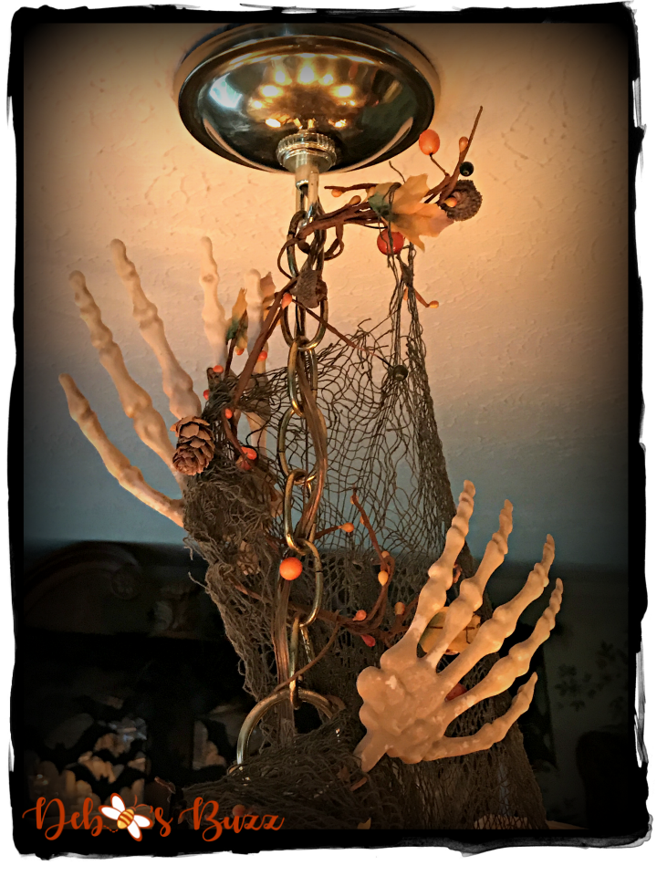 haunted-halloween-hallows-tablescape-skeleton-hands-chandelier