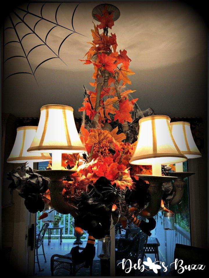 spooky-Halloween-tablescape-eye-newt-chandelier-spiderweb