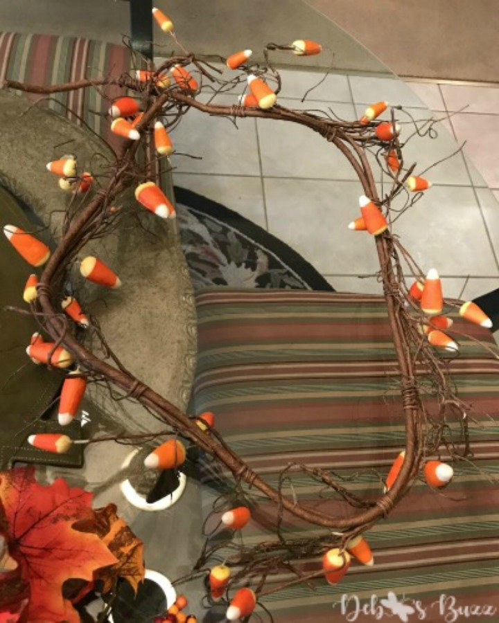 decorate-a-chandelier-fall-easy-steps-candy-corn-garland