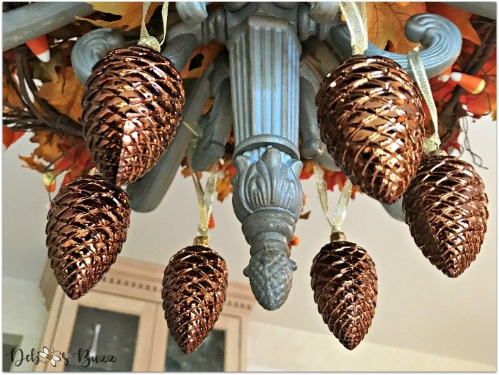 decorate-chandelier-fall-easy-steps-pinecones-feature