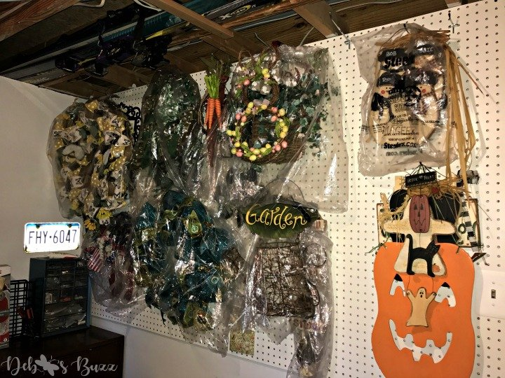 store-holiday-decorations-wreaths-pegboard