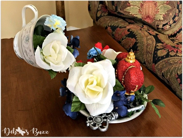 Alice-in-wonderland-floating-teacup-centerpiece-Etsy-Debbeesbuzzboutique-blue-white-roses