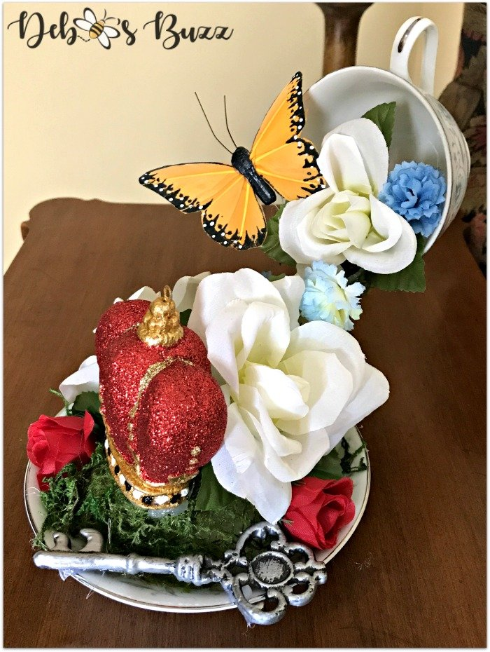 Alice-in-wonderland-floating-teacup-centerpiece-Etsy-Debbeesbuzzboutique-butterfly-side