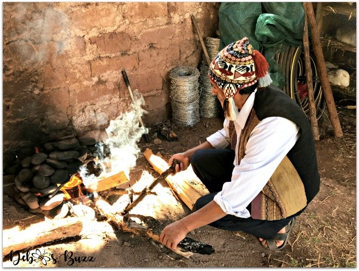 Peru-Sacred-Valley-man-traditional-stone-cooking