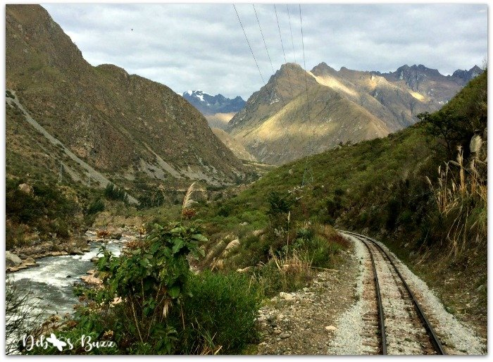peru-rail-river-snow-capped-andes