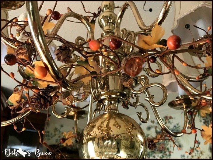 fall-decorated-chandelier-brass-twig-garlands