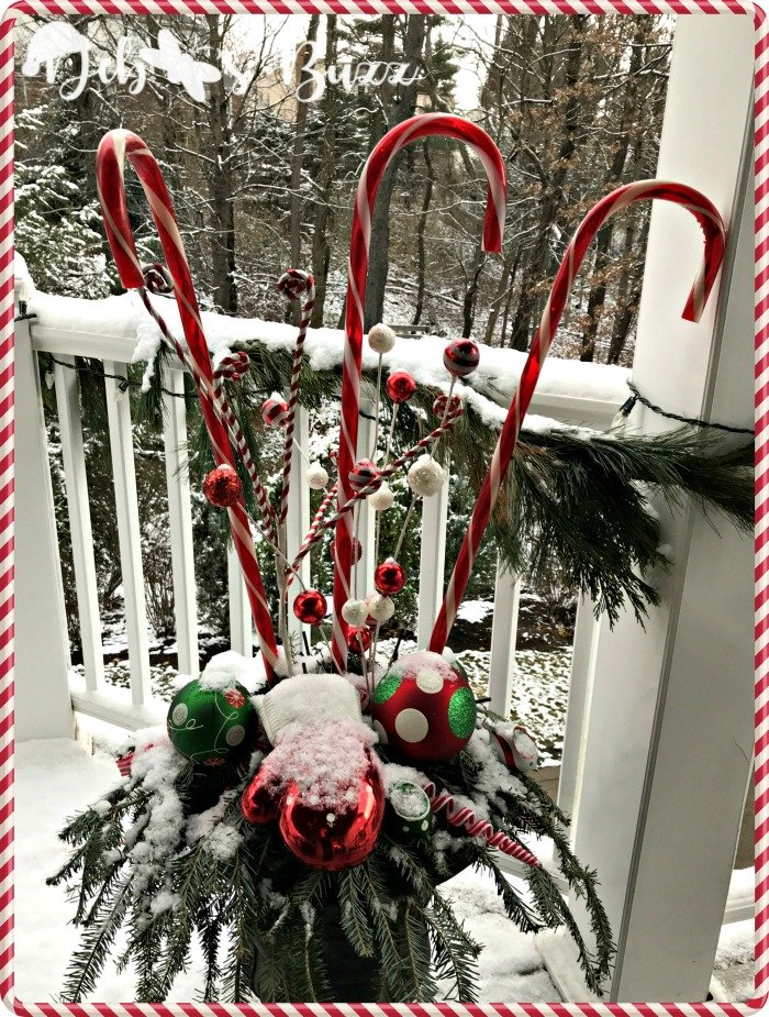 snow-covered-candy-cane-decorated-christmas-urn