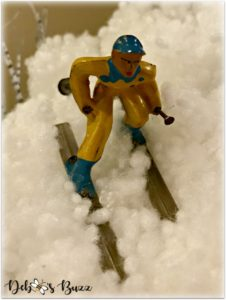 vintage-metal-male-ski-figure-yellow