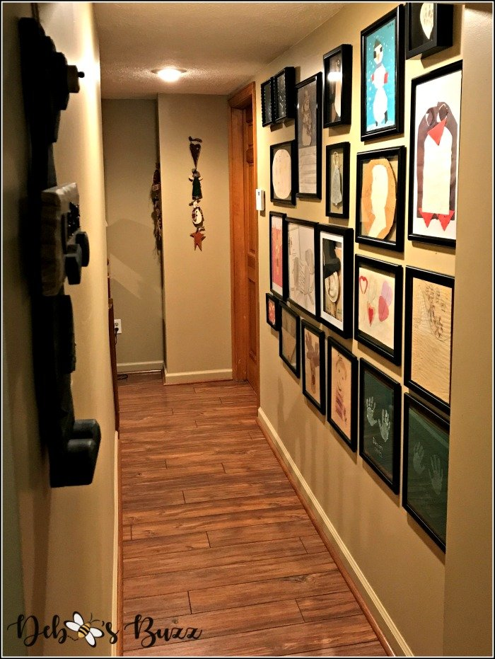 finished-basement-hallway-kids-art-gallery