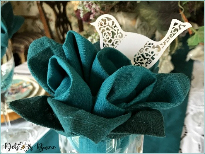 teal-flower-napkin-fold-bird-place-card