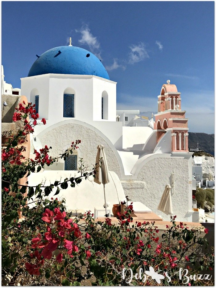 Santorini-Greece-Oia-blue-domed-church-pink-belltower
