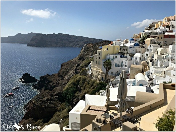 Santorini-Greece-Oia-colorful-terraced-buildings-catamarans