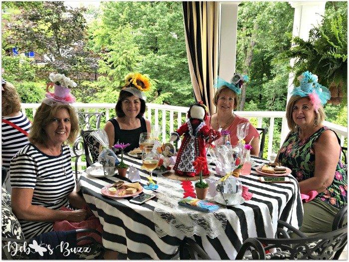 wonderland-porch-unbirthday-party-queen-table-friends