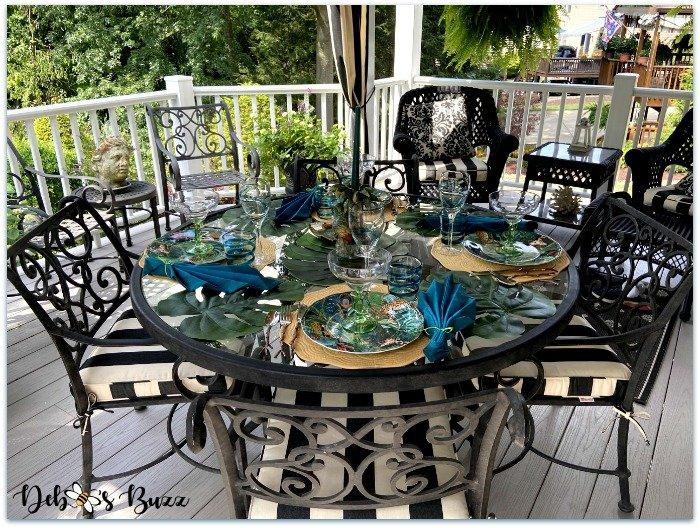 summer-safari-table-covered-porch-setting