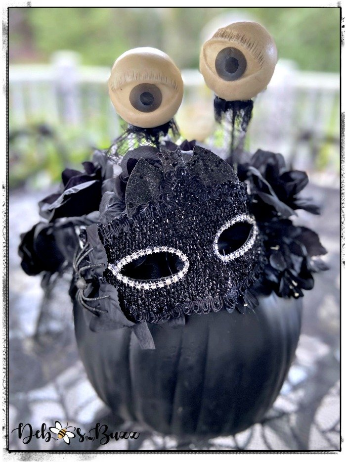 masked-black-pumpkin-decor-eyeballs