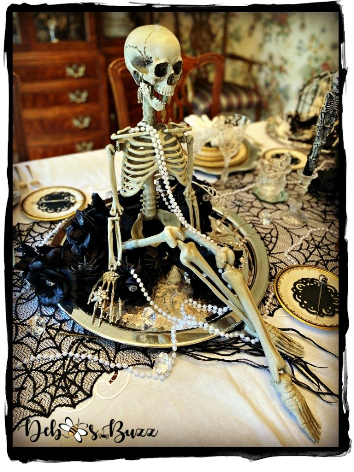 Halloween-silly-skeleton-pose-sitting-silver-tray