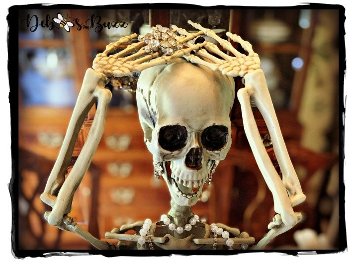 posed-silly-skeleton-hands-over-head-yoga