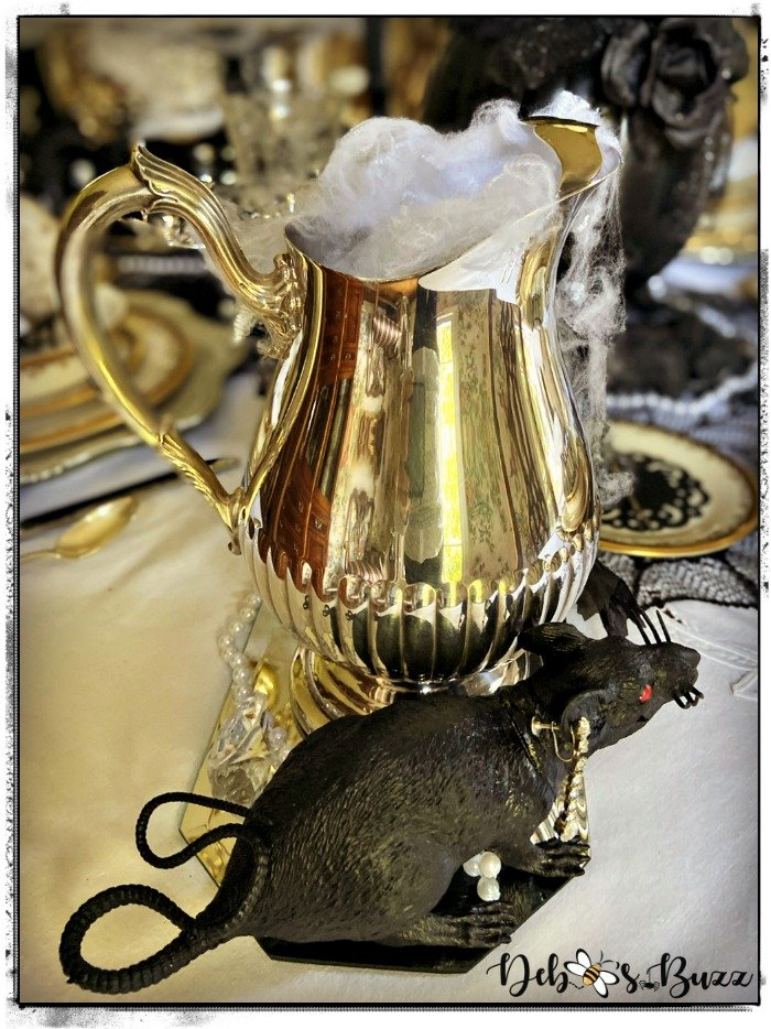 silver-water-pitcher-black-rat