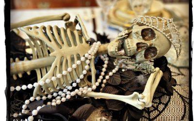 Silly Skeleton Poses on Elegant Halloween Table