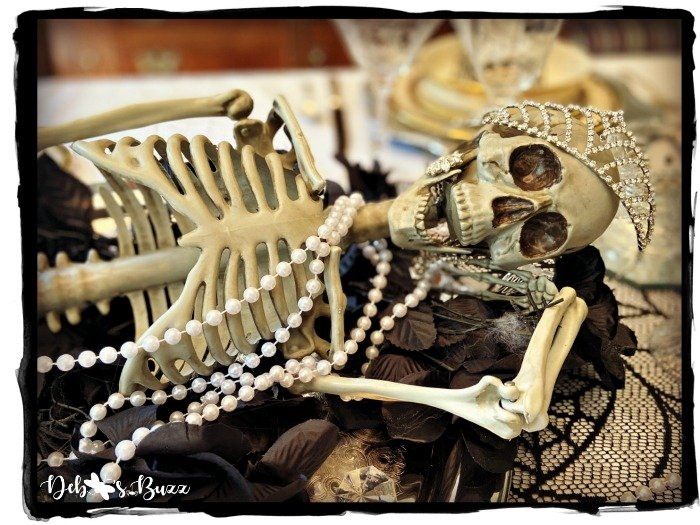 Silly Skeleton Poses on Elegant Halloween Table