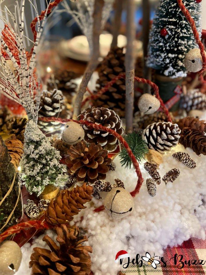 woodland-centerpiece-pinecones-sleigh-bells